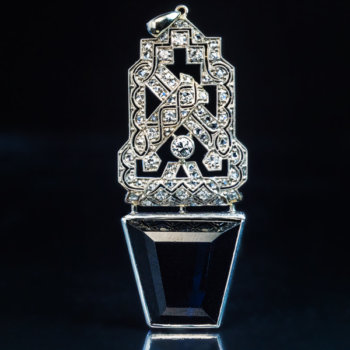 Art Deco openwork platinum diamond and tapered step cut sapphire pendant