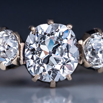 antique three stone diamond engagement ring