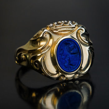 antique gold armorial signet ring with a lapis lazuli intaglio crest