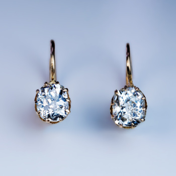 antique cushion cut diamond solitaire earrings