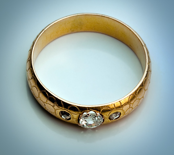 An Antique Wedding Ring This gold and diamond men