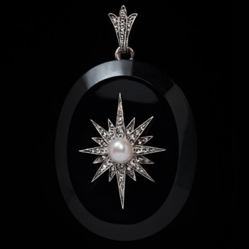 antique Victorian jet locket pendant with a diamond and pearl star