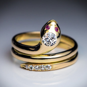 antique diamond and gold snake ring with ruby eyes