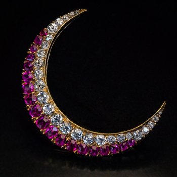 Antique Victorian crescent moon brooch with diamonds and rubies
