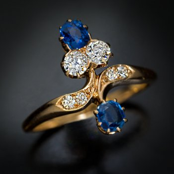 Antique sapphire diamond floral bypass gold ring