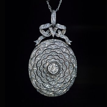 Belle Epoque jewelry - an antique Edwardian diamond and platinum locket necklace