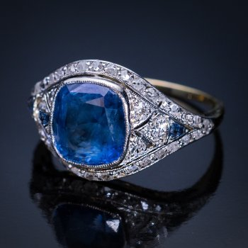 Antique cushion cut sapphire engagement ring