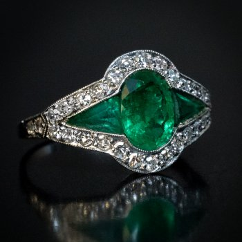 Art Deco emerald and diamond engagement ring crafted in platinum c. 1925