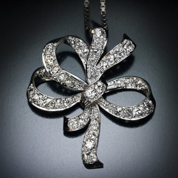 Art Deco era vintage diamond and platinum bow pendant necklace
