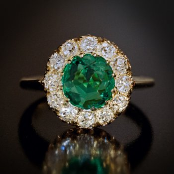 Antique emerald and old mine cut diamond engagement ring