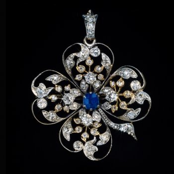 Belle Epoque antique clover shaped pendant brooch embellished with diamonds and a sapphire