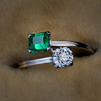 Vintage emerald diamond bypass engagement ring