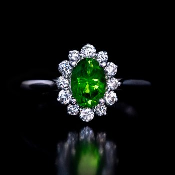 Demantoid and diamond engagement ring