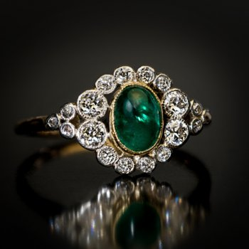 antique cabochon cut emerald and diamond engagement ring