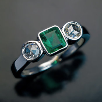 vintage emerald and diamond three stone ring