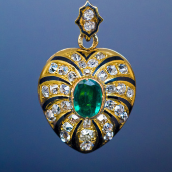 antique Victorian heart shaped gold locket embellished with emerald, diamonds and enamel