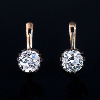 antique diamond solitaire earrings set with old cushion cut diamonds